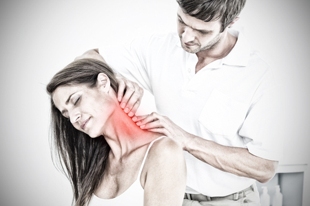 Male chiropractor massaging a young womans neck against highlighted pain