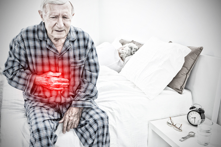 Elderly man suffering with belly pain against highlighted pain
