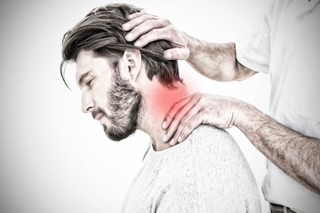 Side view of a man getting the neck adjustment done against highlighted pain