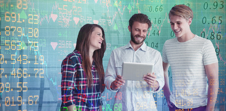 Business people discussing over digital tablet against white background against stocks and shares Stock Photo