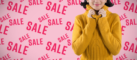 Woman in winter clothing posing against white background against pink background Reklamní fotografie