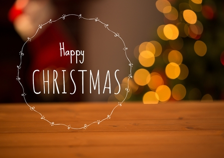 Digital composite of Happy Christmas text with home