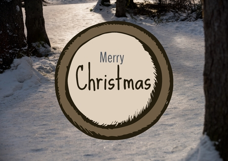 Digital composite of Merry Christmas text with snow forest Фото со стока