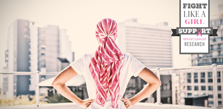 Breast cancer awareness message against confident woman standing in city for breast cancer awareness Stock Photo