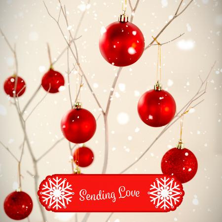 Banner sending love against red christmas balls on branches frame Stock Photo