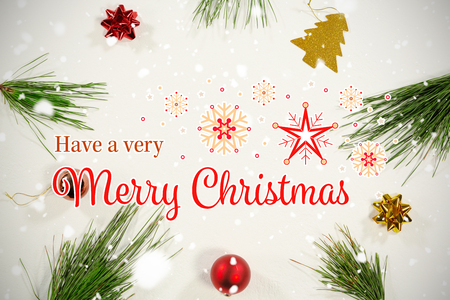 Christmas card against copy space surrounded by christmas ornaments and pine branches Stock Photo