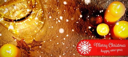 Banner Merry Christmas against christmas candles and smooth lights