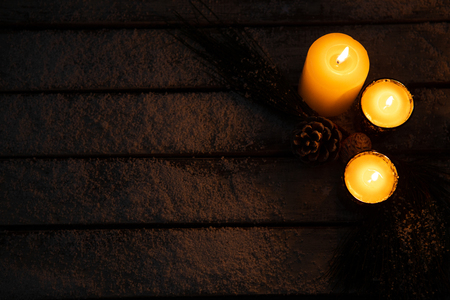 copy space with christmas candles in the night and pine cone Stock Photo
