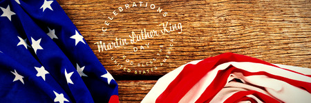 Martin Luther king day against american flag on wooden table