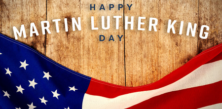happy Martin Luther King day against american flag on a wooden table Stock Photo