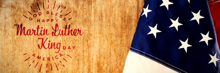Happy Martin Luther King day, god bless america against american flag on a wooden table Stock Photo - 112034405