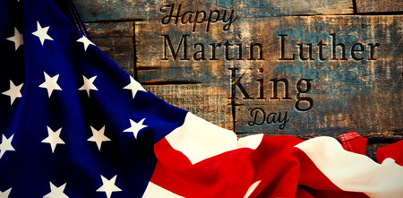 happy Martin Luther King day against american flag on a wooden table Imagens