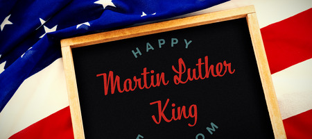 happy Martin Luther King freedom against blank slate on national flag