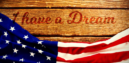 I have a dream against american flag on a brown table