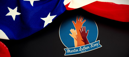 Martin Luther king day with hands against american flag on blank slate Stock Photo - 111906562