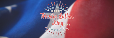 Happy Martin Luther King day, god bless america against close-up of wrinkled national flag Stock Photo