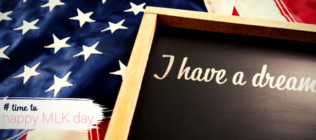# time to happy MLK day against american flag and slate on wooden table Stock Photo