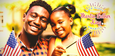 Happy Martin Luther King day, god bless america against portrait of smiling father and daughter holding american flags