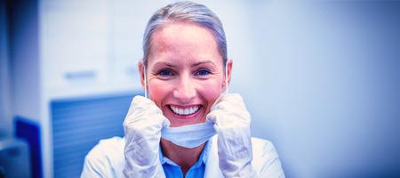 Portrait of female dentist smiling in dental clinic Stock Photo