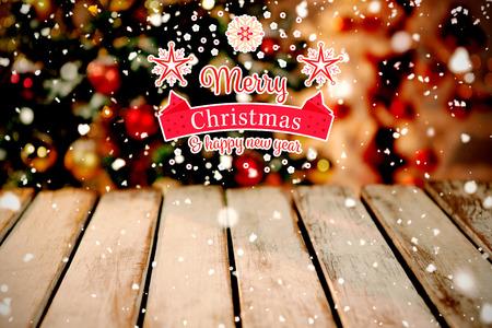 Christmas card against unfocused christmas tree with copy space Reklamní fotografie