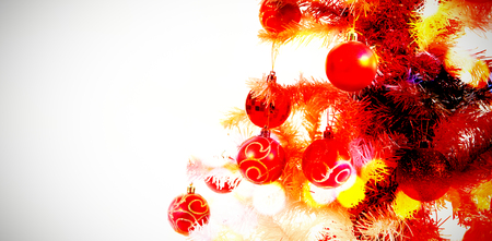Composite image of table against close-up of christmas tree with decoration Imagens