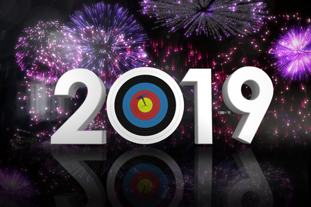 Numbers 2019 with sports target and arrow against colourful fireworks exploding on black background