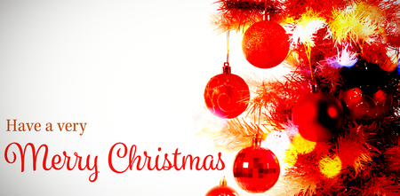 Christmas greeting against composite image of christmas tree Stock Photo