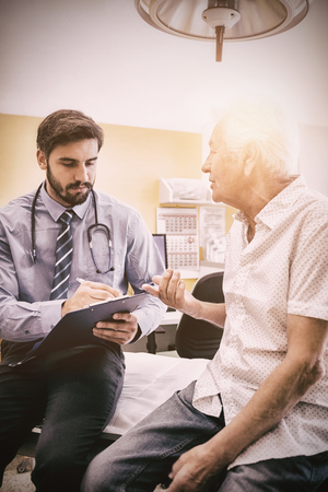 Patient consulting a doctor in the hospital Stock Photo