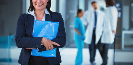 Portrait of confident businesswoman holding file in hospital 写真素材 - 112401812
