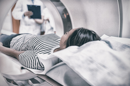Female patient undergoing CT scan in hospital Standard-Bild