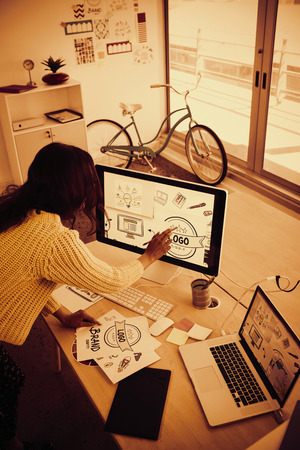 High angle view of female graphic designer working in creative office Imagens