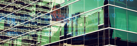 interface against close-up of glass office building