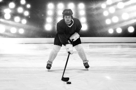 Player playing ice hockey against composite image of spotlight
