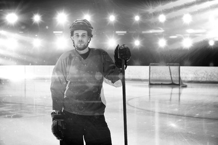 Portrait of ice hockey player at rink against composite image of blue spotlight