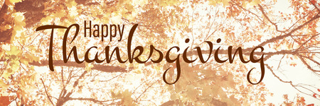 Illustration of happy thanksgiving day text greeting against  low angle view of tree against blue sky Banco de Imagens