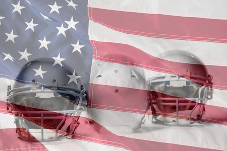 Sports helmet arranged side by side against close-up of an american flag