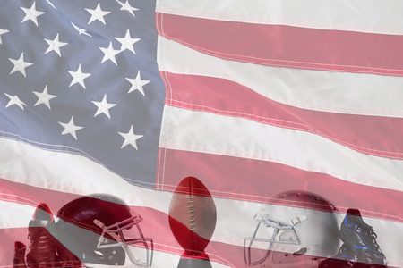 American football on tee by sports shoes and helmets against close-up of an american flag