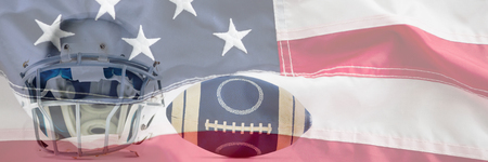 Sports helmet and American football against full frame of american flag Stock Photo