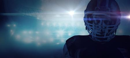 American football player standing in helmet against american football arena