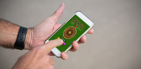 Online Roulette Game  against cropped image of man using phone