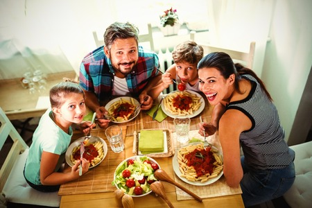 High angle view of family having meal together at home