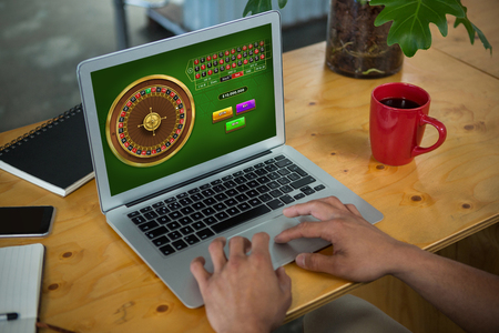 Online Roulette Game  against laptop Stock fotó