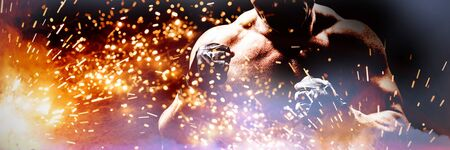 Shadow falling on confident fighter against firework bursting sparkle background Stock Photo