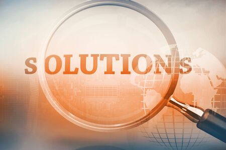 Magnifying glass showing solutions word on grey background Banco de Imagens