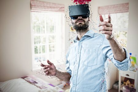 Low angle view of man using vr headset against bedroom