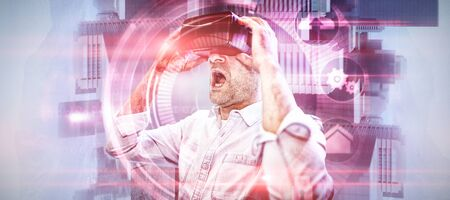 Businessman holding virtual glasses against pink technology dial interface design