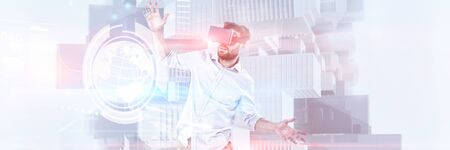Happy male using vr rift headset against composite image of technology interface