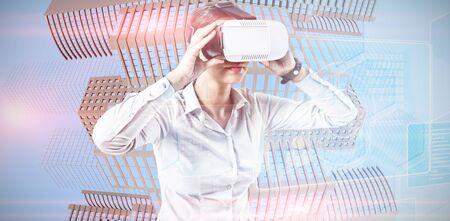 Female executive using virtual reality headset against futuristic technology interface