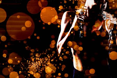 Midsection of female athlete with chain against firework bursting sparkle background