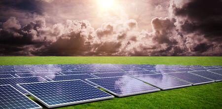 Blue solar panels against grass
